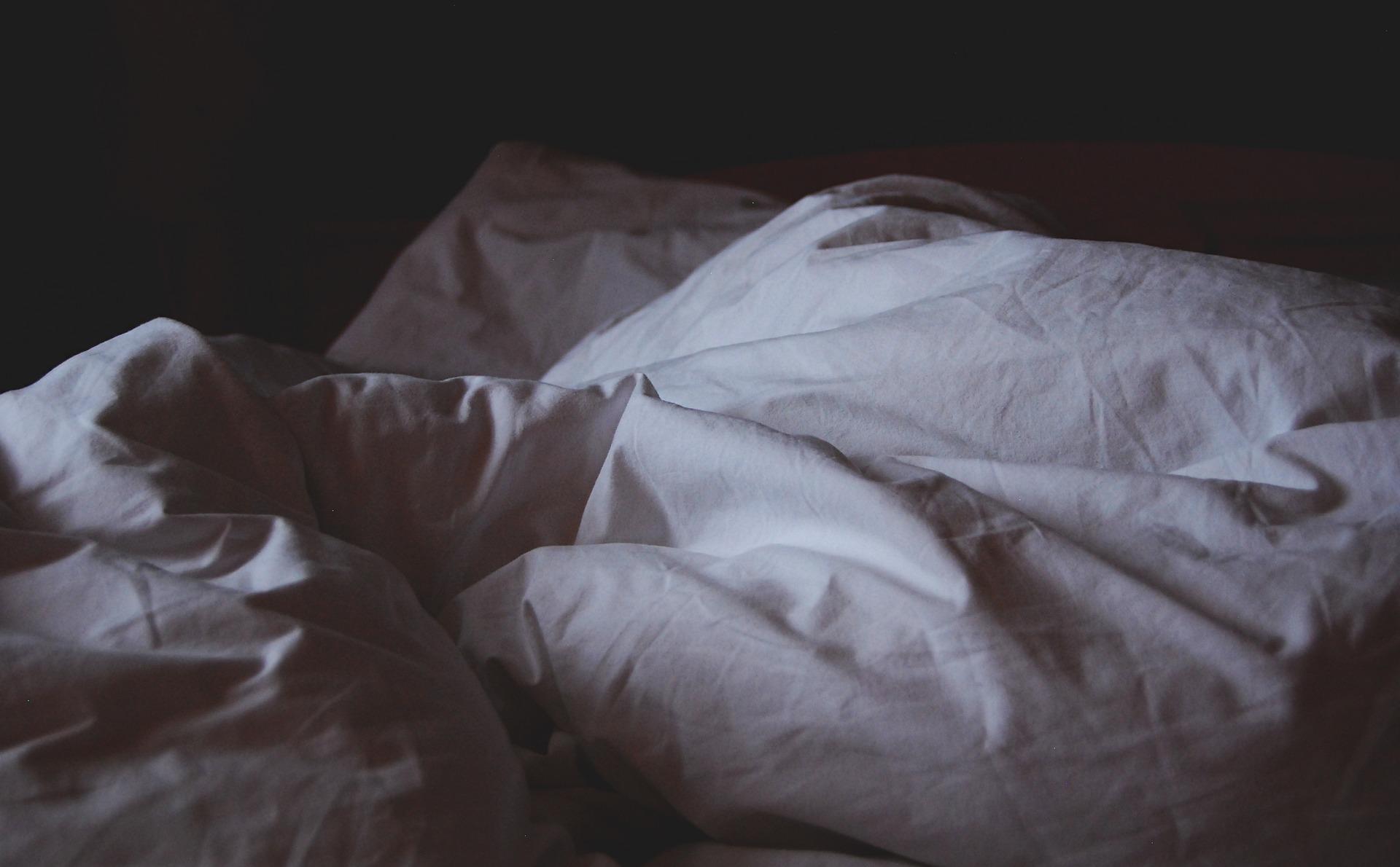 Ruffled sheets on bed - Bondage Bunnies